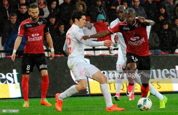 Guingamp's French forward Yannis Salibur vies with Nancy's French defender Vincent Muratori during the French L1 football match Guingamp against...