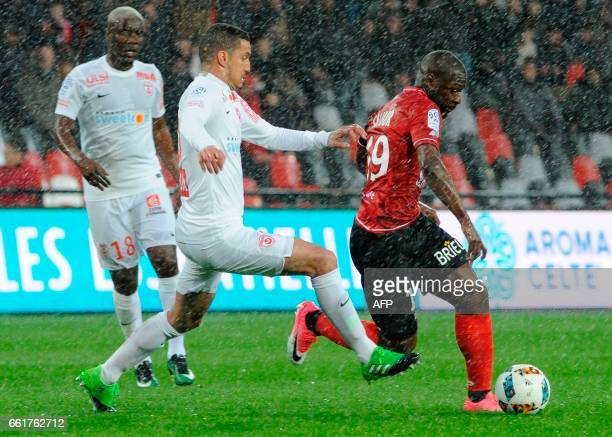 Guingamp's French forward Yannis Salibur vies with Nancy's Morrocan forward Youssouf Hadji and Nancy's Mauritanian midfielder Dialo Guidileye during...