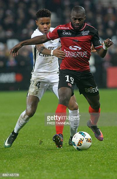 Guingamp's French forward Yannis Salibur vies with Paris SaintGermain's French midfielder Christopher Nkunku during the French L1 football match...