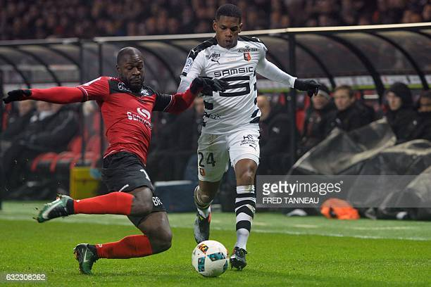 Guingamp's French forward Yannis Salibur vies with Rennes' French defender Ludovic Baal during the French Ligue 1 football match between Guingamp and...