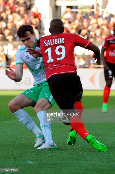 Guingamp's French forward Yannis Salibur vies with SaintEtienne's Norwegian midfielder Ole Selnaes during the French Ligue 1 football match Guingamp...