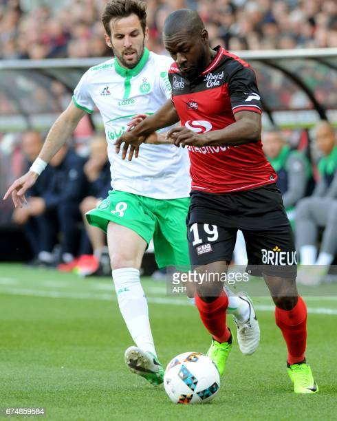 Guingamp's French forward Yannis Salibur vies with SaintEtienne's French midfielder Benjamin Corgnet during the French Ligue 1 football match...
