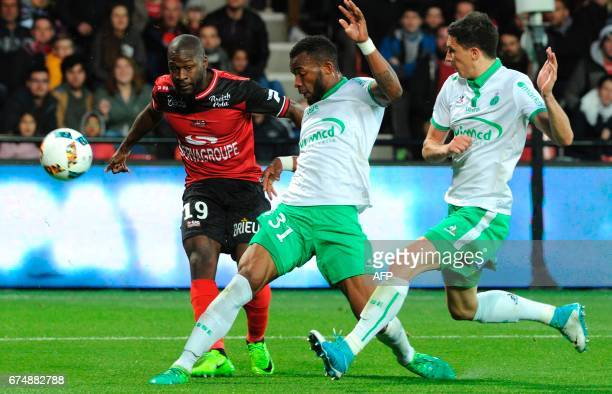 Guingamp's French forward Yannis Salibur vies with SaintEtienne's French forward Arnaud Nordin and SaintEtienne's French midfielder Vincent Pajot...