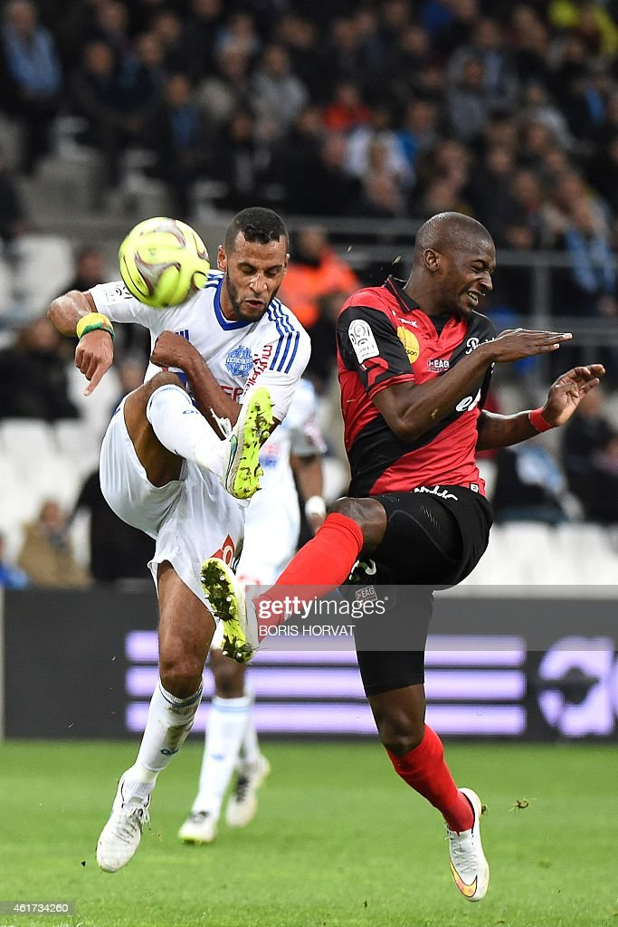 Guingamp's French Mauritanian midfielder Younousse Sankhare (R) vies for the ball with Marseille's Togolese midfielder Jacques-Alaixys Romao (L) during the French L1 football match between Olympique of Marseille (OM) and Guingamp at the Velodrome stadium in Marseille, on January 18, 2015.