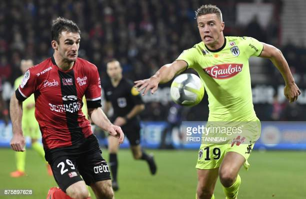 Guingamp's French midfielder Christophe Kerbrat vies with Angers' French forward Baptiste Guillaume during the French L1 football match Guingamp vs...