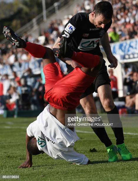 Guingamp's French midfielder Christophe Kerbrat vies with FrejusSaint Raphaël's defender Fernando Marcal De Oliveira during the French Cup final...