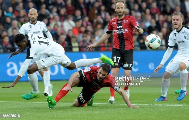 Guingamp's French midfielder Christophe Kerbrat vies with Metz' French forward Opa N'Guette during the French L1 football match EAG Guingamp against...