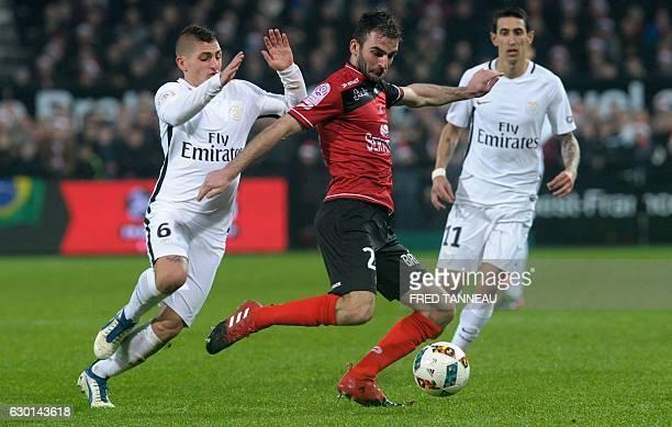 Guingamp's French midfielder Christophe Kerbrat vies with Paris SaintGermain's Italian midfielder Marco Verratti and Paris SaintGermain's Argentinian...