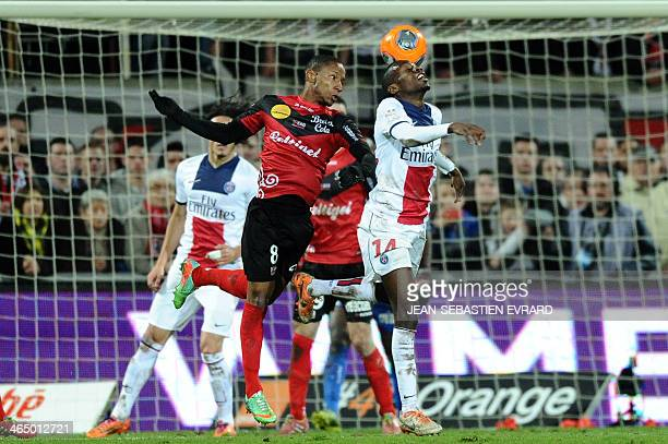 Guingamp's French midfielder Claudio Beauvue vies for the ball with Paris SaintGermain's French midfielder Blaise Matuidi during the French L1...