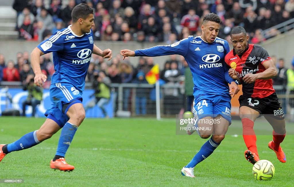 Guingamp's French midfielder Claudio Beauvue (L) vies with Lyon's French midfielder Corentin Tolisso (M) and Lyon's French defender Lindsay Rose during the French L1 football match between Guingamp and Lyon on April 4, 2015 at the Roudourou stadium in Guingamp, western of France.