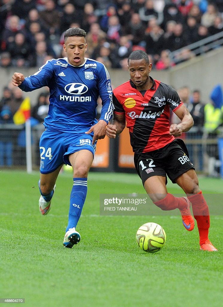 Guingamp's French midfielder Claudio Beauvue (L) vies with Lyon's French midfielder Corentin Tolisso during the French L1 football match between Guingamp and Lyon on April 4, 2015 at the Roudourou stadium in Guingamp, western of France.
