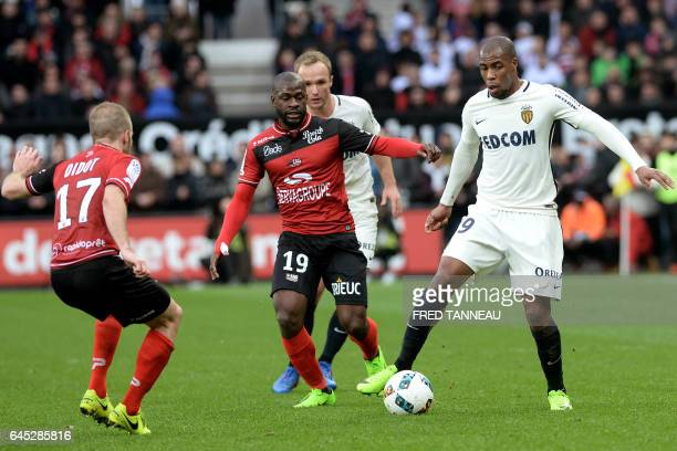 Guingamp's French midfielder Etienne Didot and Guingamp's French forward Yannis Salibur vie with Monaco's French defender Djibril Sidibe during the...