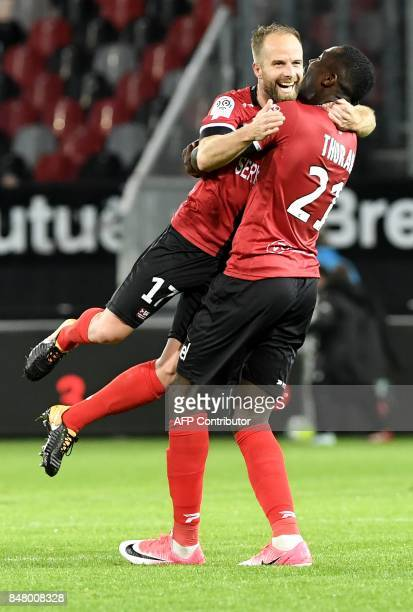 Guingamp's French midfielder Etienne Didot celebrates with Guingamp's French forward Marcus Thuram during the French L1 football match between...