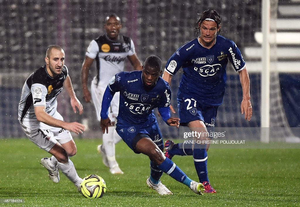 Guingamp's French midfielder <a gi-track='captionPersonalityLinkClicked' href=/galleries/search?phrase=Lionel+Mathis&family=editorial&specificpeople=832807 ng-click='$event.stopPropagation()'>Lionel Mathis</a> (L) vies with Bastia's French Togolese midfielder <a gi-track='captionPersonalityLinkClicked' href=/galleries/search?phrase=Floyd+Ayite&family=editorial&specificpeople=5969808 ng-click='$event.stopPropagation()'>Floyd Ayite</a> and Bastia's Belgian midfielder <a gi-track='captionPersonalityLinkClicked' href=/galleries/search?phrase=Guillaume+Gillet&family=editorial&specificpeople=4542498 ng-click='$event.stopPropagation()'>Guillaume Gillet</a> (R) during the French L1 football match Bastia vs Guingamp, on March 21, 2015 at the Parsemain stadium in Fos-sur-Mer. AFP PHOTO / ANNE-CHRISTINE POUJOULAT