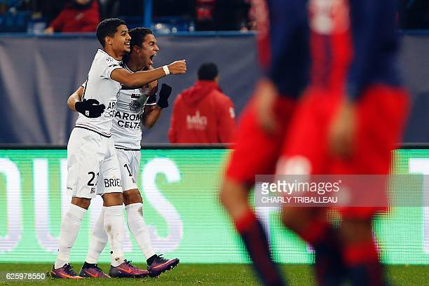 Guingamp's French midfielder Ludovic Blas and Guingamp's Belgian midfielder Nill de Pauw react during the French L1 football match between Caen and...