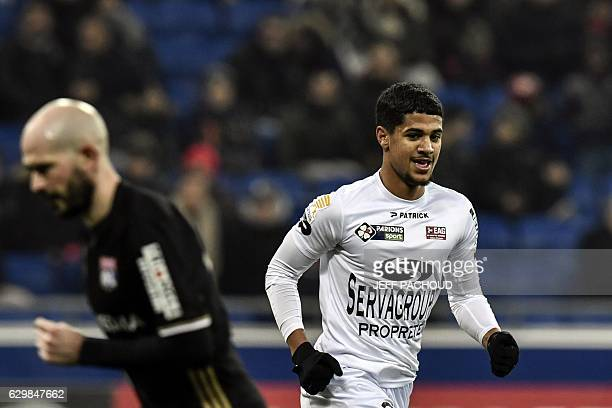 Guingamp's French midfielder Ludovic Blas celebrates after scoring a goal during the French League Cup football match between Olympique Lyonnais and...