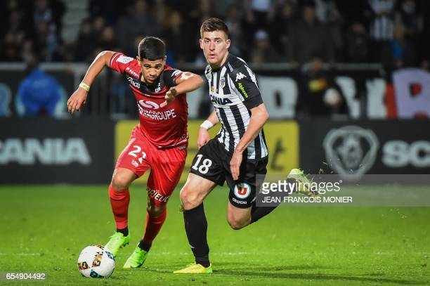 Guingamp's French midfielder Ludovic Blas vies with Angers' French midfielder Baptiste Santamaria during the French L1 football match between Angers...