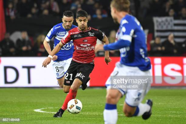 Guingamp's French midfielder Ludovic Blas vies with Bastia's French midfielder Gael Danic during the French L1 football match Guingamp against Bastia...