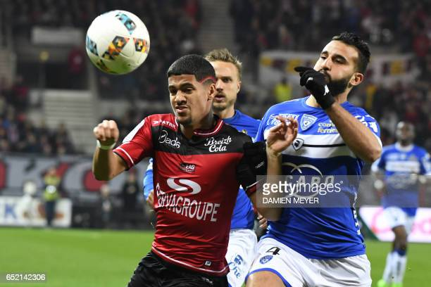 Guingamp's French midfielder Ludovic Blas vies with Bastia's Moroccan Abdelhamid El Kaouatari during the French L1 football match Guingamp against...