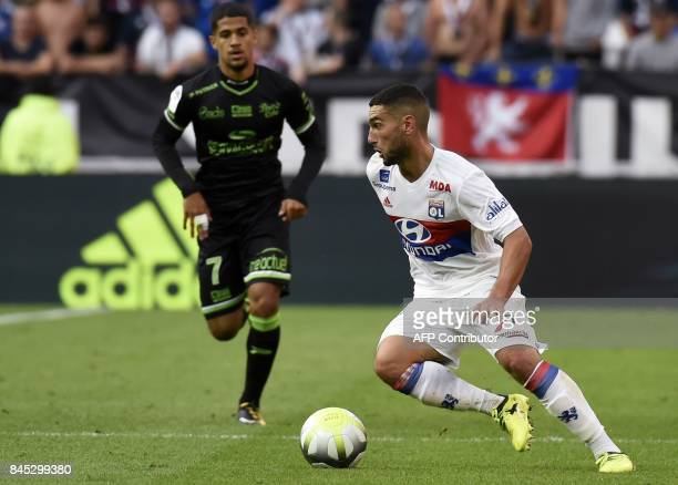 Guingamp's French midfielder Ludovic Blas vies with Lyon's French midfielder Jordan Ferri during the French L1 football match Lyon vs Guingamp on...