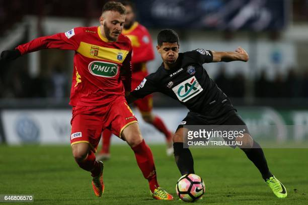 Guingamp's French midfielder Ludovic Blas vies with Quevilly Rouen's French midfielder Anthony Rogie during the French Cup football match between...