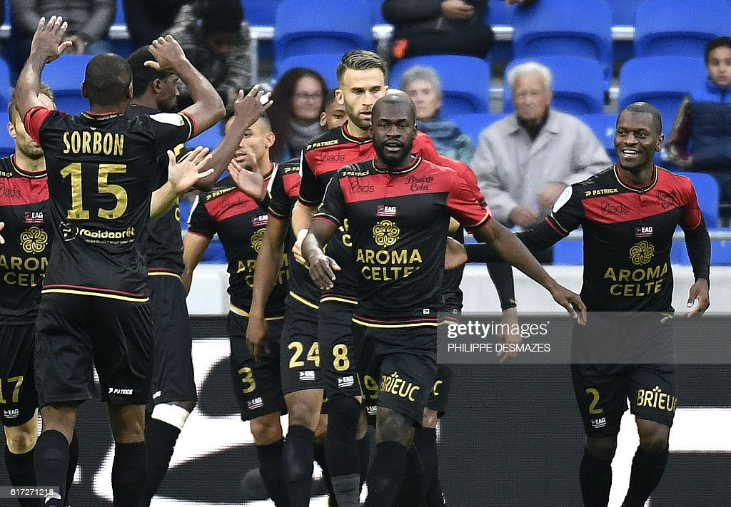 Guingamp's French midfielder Yannis Salibur (C) celebrates with his teammate after scoring a goal during the French L1 football match between Olympique Lyonnais and EA Guingamp on October 22, 2016, at the Parc Olympique Lyonnais in Decines-Charpieu near Lyon, southeastern France. / AFP / PHILIPPE