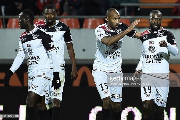 Guingamp's French midfielder Yannis Salibur celebrates with his teammates after scoring a goal during the French L1 football match between Lorient...