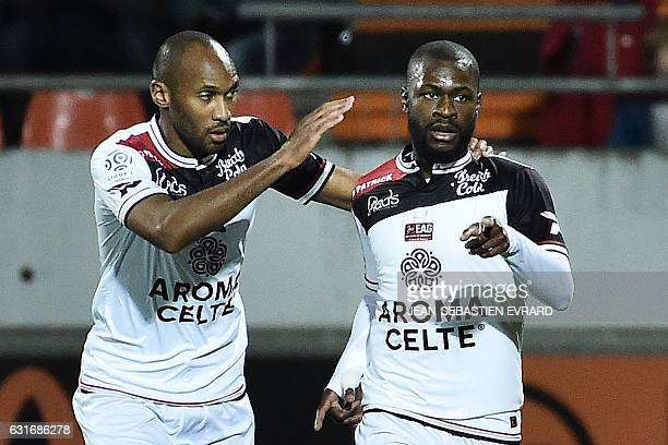 Guingamp's French midfielder Yannis Salibur celebrates with his teammate French defender Jeremy Sorbon after scoring a goal during the French L1...