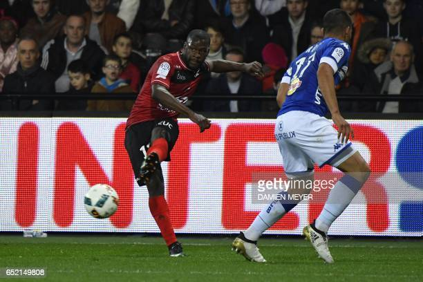 Guingamp's French midfielder Yannis Salibur kicks the ball during the French L1 football match Guingamp against Bastia on March 11 2017 at the...