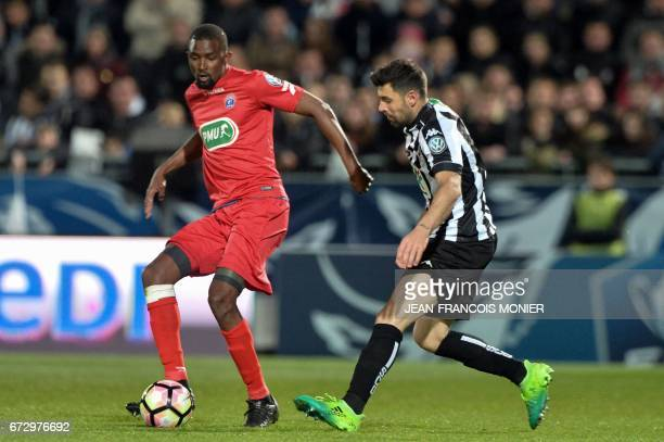 Guingamp's French midfielder Yannis Salibur vies for the ball with Angers' French midfielder Thomas Mangani during the French Cup semifinal match...