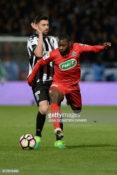Guingamp's French midfielder Yannis Salibur vies with Angers' French midfielder Thomas Mangani during the French Cup semifinal football match between...