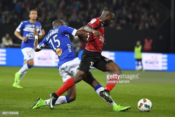 Guingamp's French midfielder Yannis Salibur vies with Bastia's Congolese midfielder Prince Oniangue during the French L1 football match Guingamp...