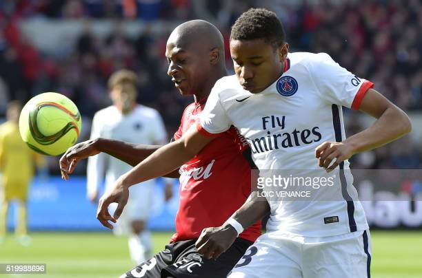 Guincamp's French midfielder Younousse Sankhare vies with Paris SaintGermain's French defender Presnel Kimpembe during the French L1 football match...