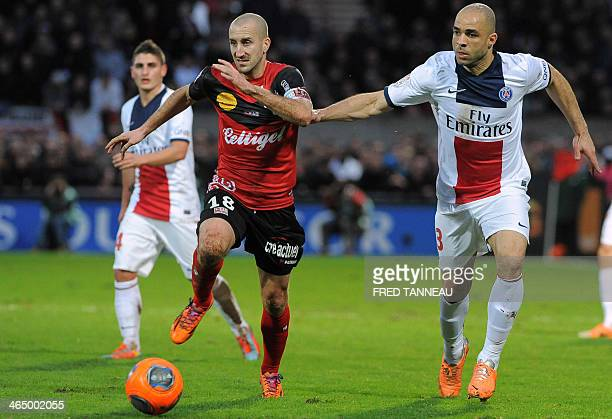Guingamp's French midfileder and captain Lionel Mathis vies for the ball with Paris SaintGermain's Brazilian defender Alex Costa during the French L1...