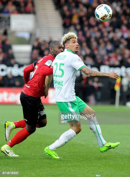 Guingamp's FrenchCongolese defender Jordan Ikoko vies with SaintEtienne's French defender Kevin Malcuit during the French Ligue 1 football match...
