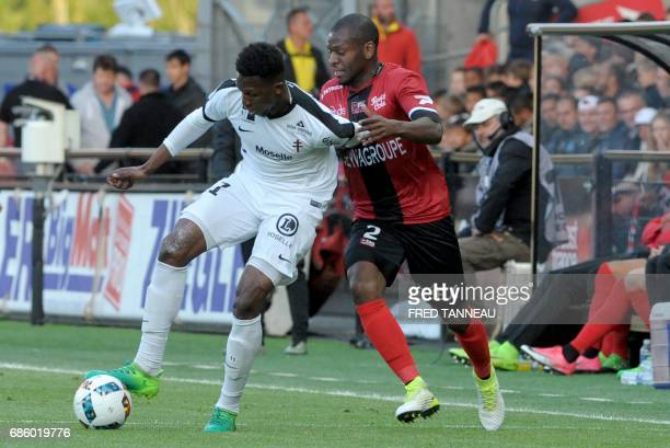 Guingamp's FrenchCongolese defender Jordan Ikoko vies with Metz' French forward Opa N'Guette during the French L1 football match EAG Guingamp against...