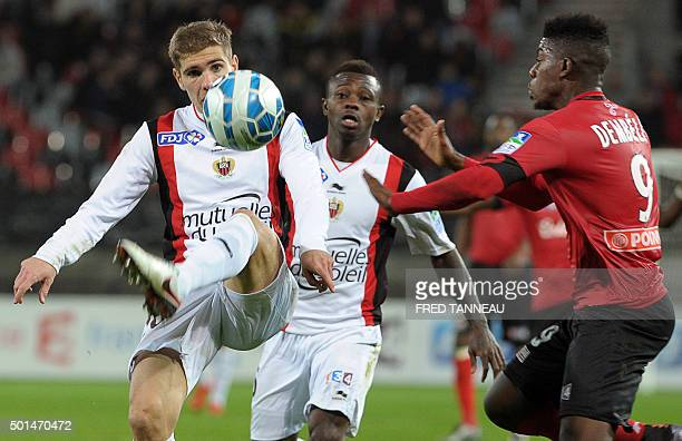Guingamp's FrenchMalian forward Mana Dembele vies with Nice's French defender Maxime Le Marchand during the French League Cup football match between...