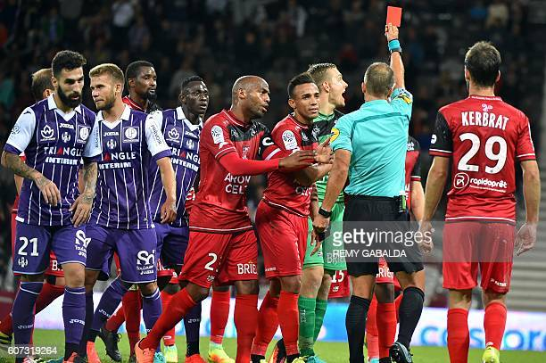 Guingamp's goalkeeper Karl Johnsson receives a red card during the French L1 football match Toulouse against Guingamp on September 17 at the...