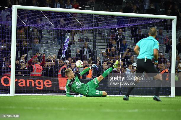 Guingamp's goalkeeper Theo Guivarch concedes a penalty during the French L1 football match Toulouse against Guingamp on September 17 2016 at the...