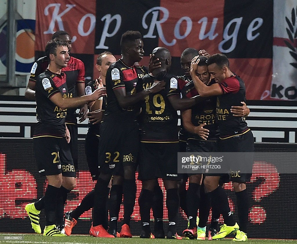 Guingamp's players celebrate after scoring a goal during the French L1 football match between Nancy and Guingamp on August 27 2016 at Marcel Picot...