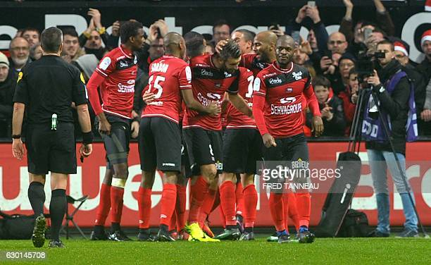 Guingamp's players celebrate after scoring during the French L1 football match Guingamp against PSG on December 17 2016 at the Roudourou stadium in...