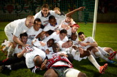 Guingamp's players celebrate after winning the French L2 football match Ajaccio vs Guingamp on May 17 2013 at the Jean Laville stadium in Gueugnon...