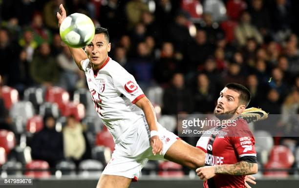 Guingamp's Portuguese defender Pedro Rebocho vies with Lille's French forward Anwar El Ghazi during the French L1 football match between Guingamp and...