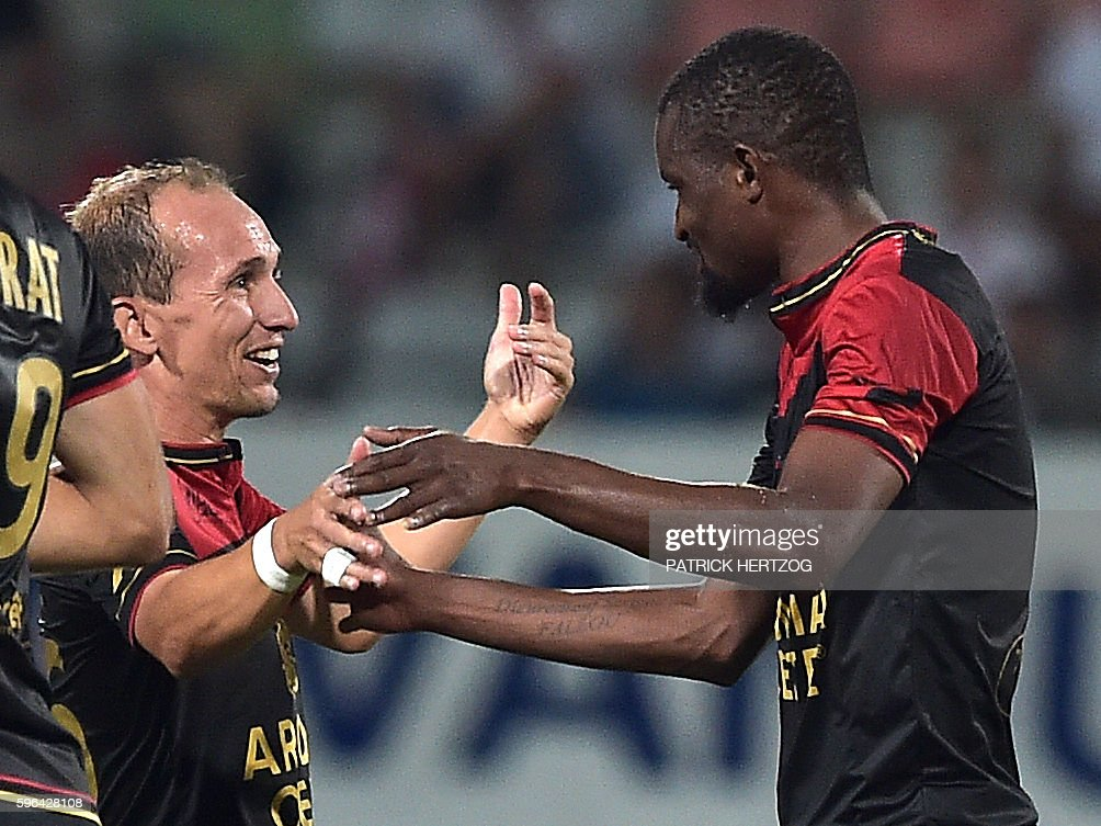 Guingamp's Senegalese midfielder Moustapha Diallo celebrates with his teammate Guingamp's French midfielder Thibault Giresse after scoring a goal...