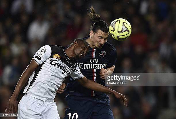 Guingamp's Senegalese midfielder Moustapha Diallo vies with Paris SaintGermain's Swedish forward Zlatan Ibrahimovic during the French L1 football...