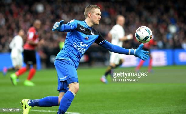 Guingamp's Swedish goalkeeper KarlJohan Johnsson clears a ball during the French L1 football match Guingamp vs Monaco on February 25 2017 at the...