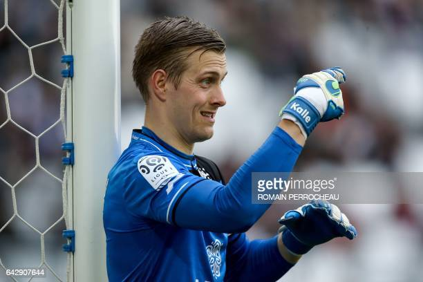 Guingamp's Swedish goalkeeper KarlJohan Johnsson gestures during the French L1 football match between Bordeaux and Guingamp on February 19 2017 at...