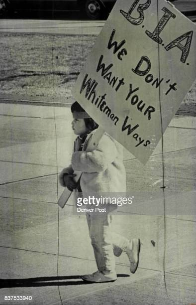 Guinn Satepauhoodle carries her mom's sign briefly She's daughter of the Cletis Satepauhoodles of Arvada Credit Denver Post Inc