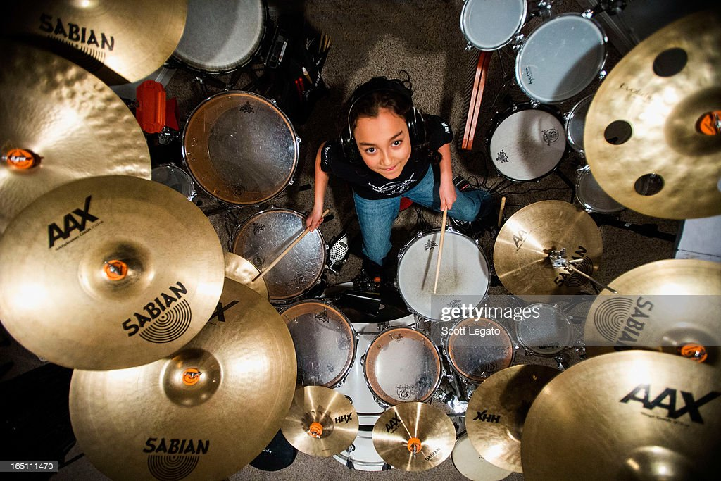 Guinness Book of World Records for Worlds Youngest Drummer, Julian Pavone, aged 8, sits in during a photo session at Julian Pavone Studio on March 30, 2013 in Macomb, Michigan.