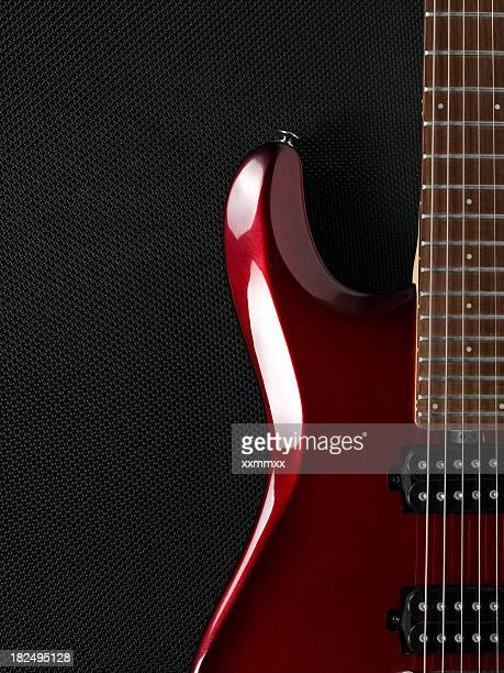 Guitar and black amplifier in the background